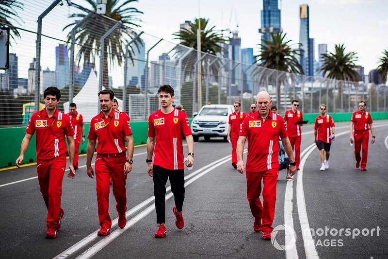 Charles Leclerc, Ferrari walks the track with members of the team including Jock Clear, Race Engineer, Ferrari.