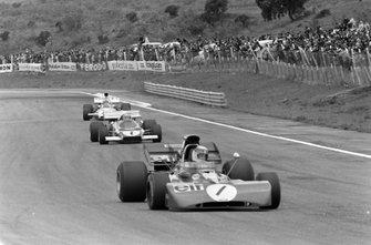 Jackie Stewart, Tyrrell 003 Ford leads Mario Andretti, Ferrari 312B2 and Denny Hulme, McLaren M19A Ford