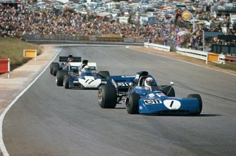 Jackie Stewart, Tyrrell 003 Ford, leads Mike Hailwood, Surtees TS9B Ford, and Emerson Fittipaldi, Lotus 72D Ford