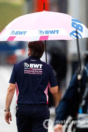 Andy Stevenson, Sporting Director, Racing Point, carries an umbrella