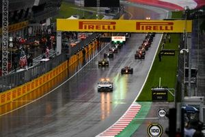 The Safety Car leads Yuki Tsunoda, Carlin, Guanyu Zhou, UNI-Virtuosi, Jehan Daruvala, Carlin, and the rest of the field away at the start