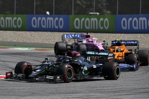 Lewis Hamilton, Mercedes F1 W11 EQ Performance, leads Lando Norris, McLaren MCL35, and Sergio Perez, Racing Point RP20