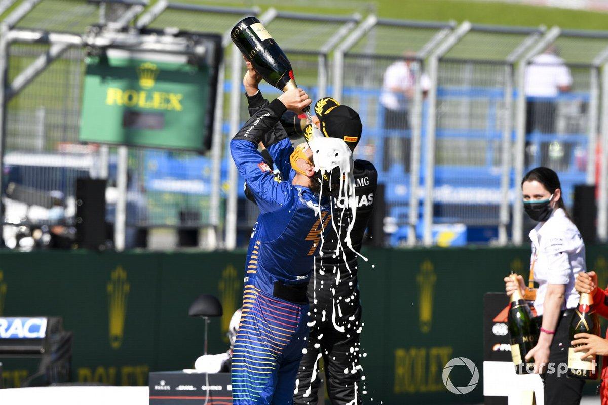 Lando Norris, McLaren celebrates with the champagne on the podium
