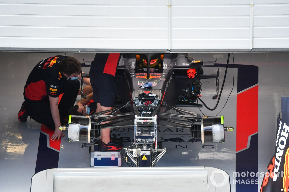 The Alexander Albon Red Bull Racing RB16 is worked on in the team's pit garage