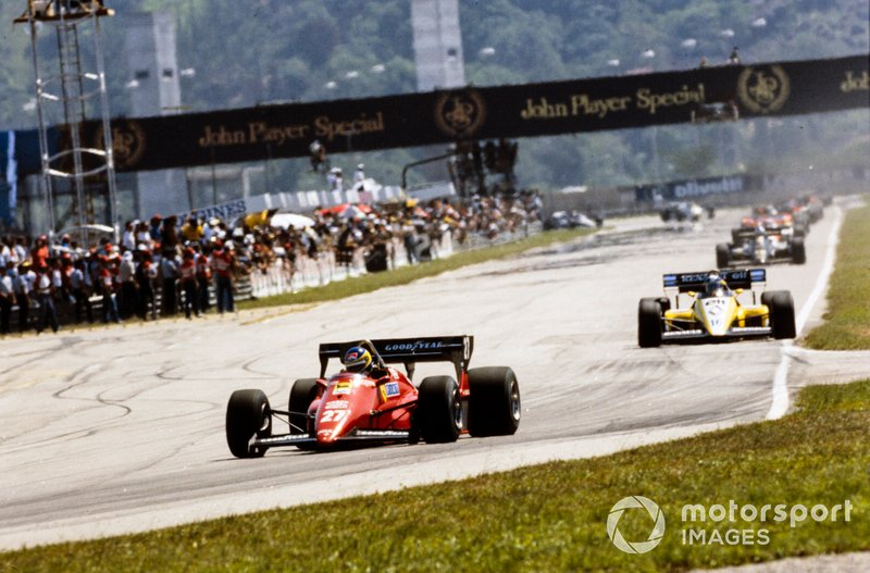 Michele Alboreto, Ferrari 126C4, leads Derek Warwick, Renault RE50