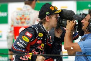 Sebastian Vettel, Red Bull Racing RB7 kisses the camera of Jean-Michel Tibi