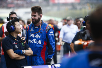 Toro Rosso Honda team members talk on the grid