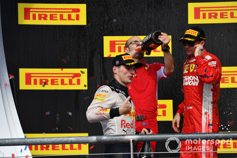 (L to R): Max Verstappen, Red Bull Racing, Carlo Santi, Ferrari Race Engineer and Race Winner Kimi Raikkonen, Ferrari celebrate with the champagne on the podium with the trophy