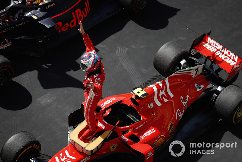Kimi Raikkonen, Ferrari SF71H, celebrates in Parc Ferme after winning the race.
