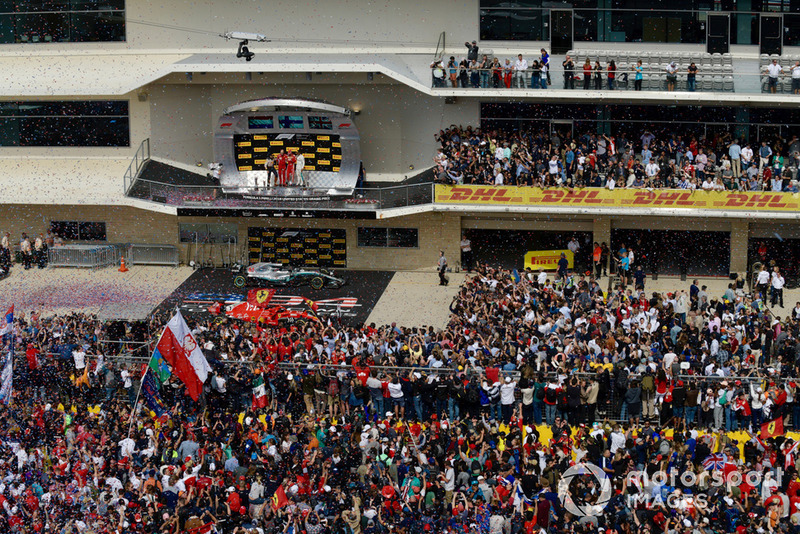 Fans on the track with Max Verstappen, Red Bull Racing, Carlo Santi, Ferrari Race Engineer, Kimi Raikkonen, Ferrari and Lewis Hamilton, Mercedes AMG F1 on the podium