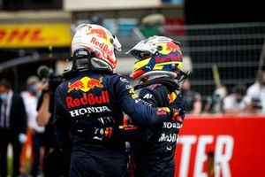 Max Verstappen, Red Bull Racing, 1st position, and Sergio Perez, Red Bull Racing, 3rd position, celebrate in Parc Ferme