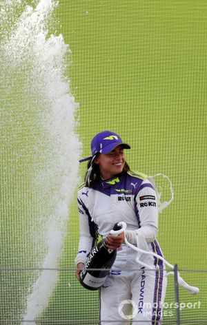 Jamie Chadwick, 1st position, sprays the victory Champagne
