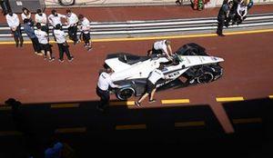 The Venturi team push the car in the pits