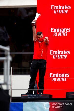 The Prema team representative celebrates on the podium with the teams trophy