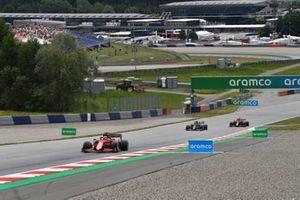 Charles Leclerc, Ferrari SF21, Yuki Tsunoda, AlphaTauri AT02, and Max Verstappen, Red Bull Racing RB16B