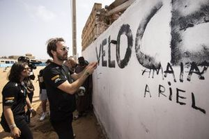 Formula E driver and Veloce Racing co-founder Jean-Eric Vergne and Jamie Chadwick, Veloce Racing paint a Veloce sing on a wall on the Eco Zone Legacy Project visit