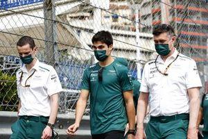 Lance Stroll, Aston Martin, walks the track with team mates