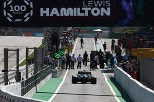 Lewis Hamilton, Mercedes W12, drives into Parc Ferme after securing his 100th pole position in F1
