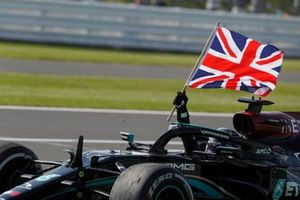 Lewis Hamilton, Mercedes W12, 1st position, waves the Union flag from his cockpit on his way to Parc Ferme