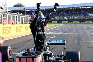 Lewis Hamilton, Mercedes, celebrates in Parc Ferme after securing pole position