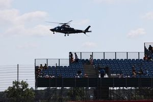 An Agusta A109E Power helicopter lands at the circuit