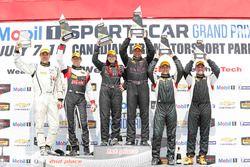 ST podium: winners #44 CRG-I Do Borrow Honda Civic Si: Sarah Cattaneo, Owen Trinkler, second place #17 RS1 Porsche Cayman: Nick Galante, Spencer Pumpelly