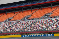 Track workers attempt to dry Charlotte Motor Speedway prior to practice