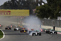 Lewis Hamilton, Mercedes AMG F1 W07 Hybrid locks a wheel under braking into turn one ahead of Max Verstappen, Red Bull Racing RB12 and Nico Rosberg, Mercedes AMG F1 W07 Hybrid