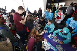 Oliver Turvey, NIO Formula E Team, signs autographs for fans