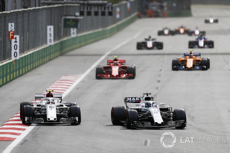 Lance Stroll, Williams FW41 Mercedes, Charles Leclerc, Sauber C37 Ferrari, Kimi Raikkonen, Ferrari SF71H y Stoffel Vandoorne, McLaren MCL33 Renault