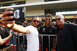 Daniel Ricciardo, Red Bull Racing, poses for fans to take a picture