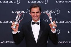 Tennis player Roger Federer holds his awards for Laureus World Comeback of the Year 2018