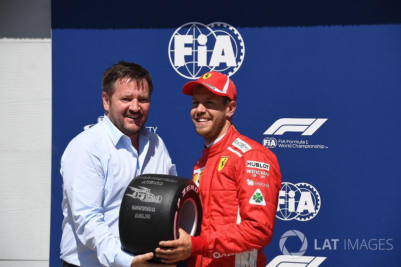 Sebastian Vettel, Ferrari receives the Pirelli Pole Position Award from Paul Hembery, Pirelli Motors