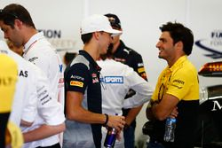 Pierre Gasly, Scuderia Toro Rosso, talks with Carlos Sainz Jr., Renault Sport F1 Team