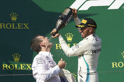 The Mercedes Constructors trophy delegate receives some Champagne refreshment from Lewis Hamilton, Mercedes AMG F1, 1st position, on the podium