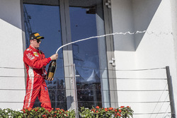 Kimi Raikkonen, Ferrari celebrates on the podium with the champagne