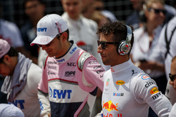 Esteban Ocon, Force India, and Daniel Ricciardo, Red Bull Racing, stand for the national anthem on the grid