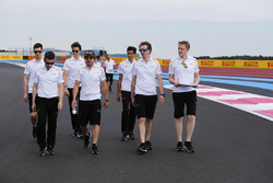 Fernando Alonso, McLaren, walks the circuit with colleagues