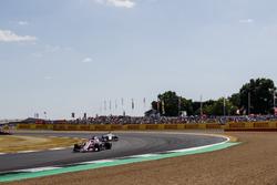 Sergio Perez, Force India VJM11, leads Marcus Ericsson, Sauber C37
