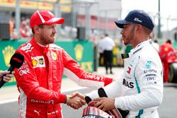 Sebastian Vettel, Ferrari, congratulates Lewis Hamilton, Mercedes AMG F1, after qualifying