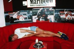Former F1 world champion James Hunt, takes a nap in the McLaren teams hospitality area