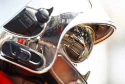 Romain Grosjean, Haas F1 Team VF-18, as seen in the reflection of a marshals helmet