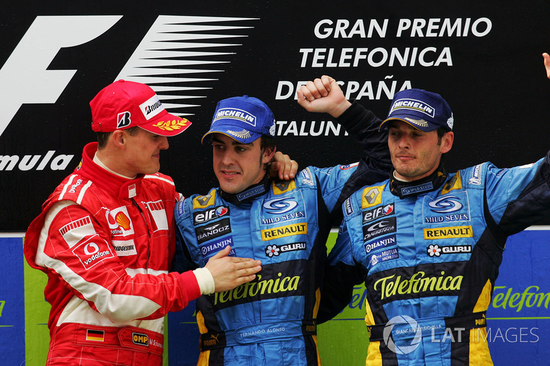 Podium: race winner Fernando Alonso, Renault, second place Michael Schumacher, Ferrari and third pla