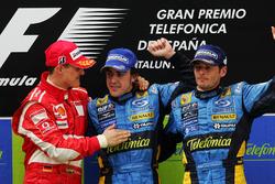 Podium: race winner Fernando Alonso, Renault, second place Michael Schumacher, Ferrari and third place Giancarlo Fisichella, Renault