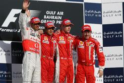 Podium: second place Lewis Hamilton, McLaren, Race winner Felipe Massa, Ferrari, third place Kimi Raikkonen, Ferrari and Luca Baldeseri
