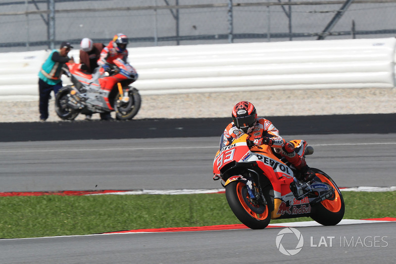 Marc Marquez, Repsol Honda Team, Dovizioso after crashing in background