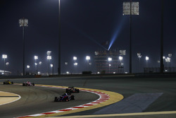 Pierre Gasly, Toro Rosso STR13 Honda, leads Kevin Magnussen, Haas F1 Team VF-18 Ferrari, and Esteban Ocon, Force India VJM11 Mercedes