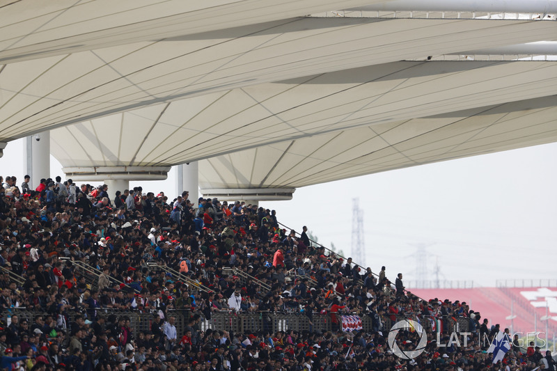 Fans in a packed grandstand