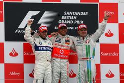 Podium: second place Nick Heidfeld, BMW Sauber F1, Race winner Lewis Hamilton, McLaren, third place Rubens Barrichello, Honda Racing F1 Team