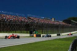 Sebastian Vettel, Ferrari SF70H leads Valtteri Bottas, Mercedes-Benz F1 W08 and Kimi Raikkonen, Fer